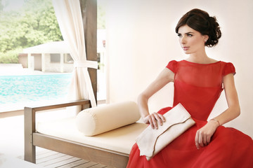 Woman in red silk dress, summer elegance