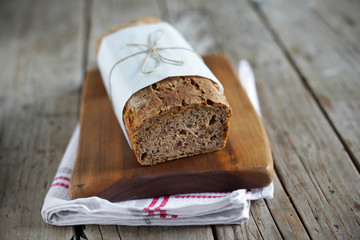 Rye bread loaf with oats, wheat and flax seeds, sliced
