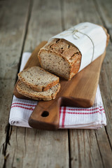 Wholegrain rye bread loaf with flax seeds and oats, sliced