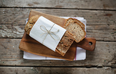 Wholegrain rye loaf bread with various seeds, sliced portions