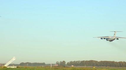 Ilyushin IL-76 heavy transport aircraft taking off.