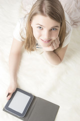 Portrait of Pretty Little Caucasian Teenager Girl  Reading Digit