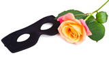 Mask and rose isolated on white background with copy-space
