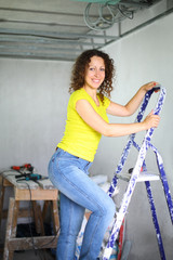 woman coming down the ladder in the room