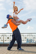 man holding girl in arms in beautiful pose during modern dance