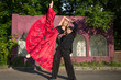 couple dancing on street against brick building