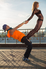 couple dancing on the street, girl is on mans knees