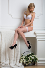 girl in lace lingerie and stockings and shoes sitting