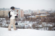 girl snowboarder in helmet steps in snow with snowboard
