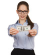 Girl holding a one hundred dollar bill