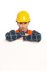Construction worker lean on banner.