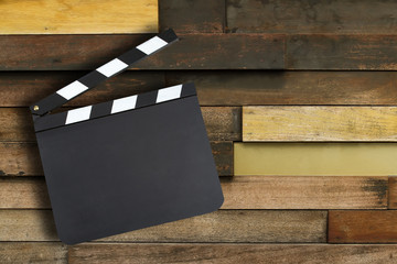 Blank movie production clapper board over vintage wooden wall