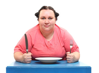 Hungry obese woman with empty plate. Diet theme.