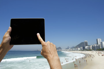 Traveling Tourist Using Tablet at Rio de Janeiro Brazil Beach