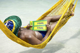 Brazilian Soccer Fan Relaxing with Tickets to Final