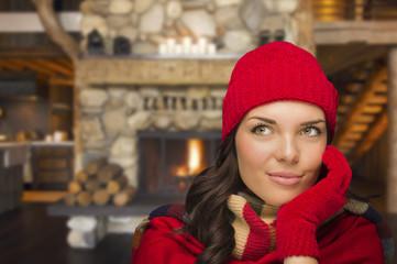 Mixed Race Girl Enjoying Warm Fireplace In Rustic Cabin
