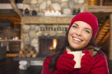 Mixed Race Girl Enjoying Warm Fireplace and Holding Mug