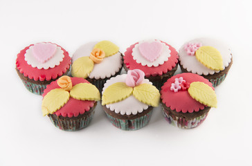 Five  cupcakes isolated on white background