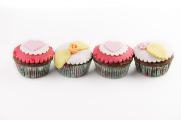 Four red cupcakes isolated on white background
