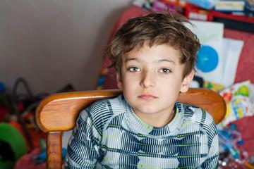 sad boy looking at camera