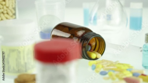 Pill Bottles and Chemistry Artificial Supplements Concept
