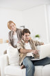 happy young couple using computer at home
