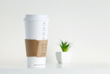 White Paper Cup and green potted plant