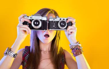 Portrait of funny girl with two cameras in their hands