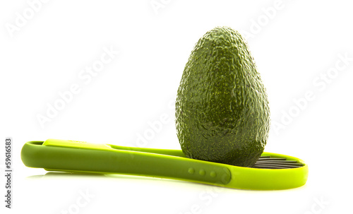 Avocados with slicer isolated on white background
