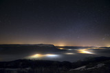 Fototapety Stars in a foggy night over the valley