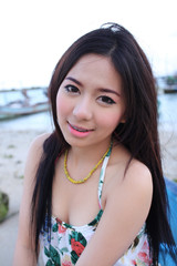 Portrait beautiful long hair asian girl relaxing by the beach