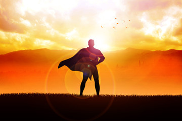A superhero standing with mountain view as the background