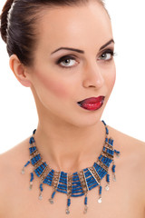 young  beautiful woman wearing blue necklace
