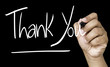Thank You hand writing on a transparent board