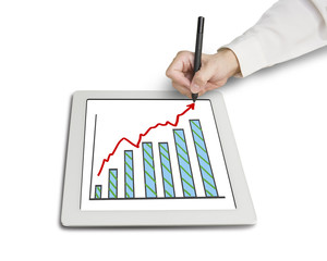 Hand drawing growth red arrow and chart on table