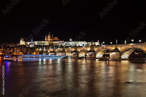 View of the Charles bridge and Saint Vitus Cathedral at night