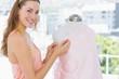 Female fashion designer working on pink fabric