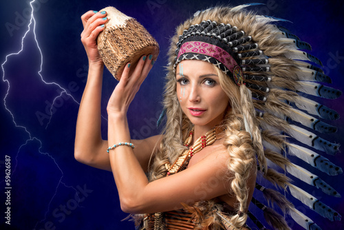 Beautiful woman in native American headpiece