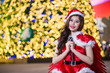 Pretty Asian girl in Santa costume for Christmas