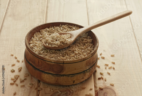 Brown rice in wooden bowl