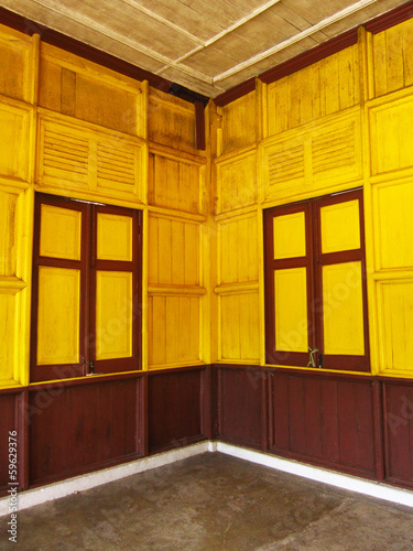Old railway station painted window with yellow and brown on wood