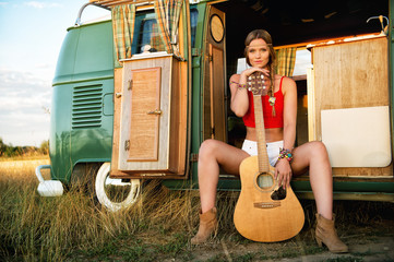cute hippie girl with guitar