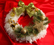 Christmas wreath on fabric background