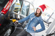 Young Woman with Santa Hat at Gas Station