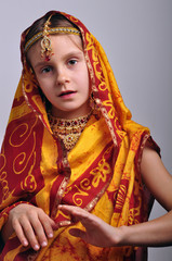 little girl in traditional Indian clothing and jeweleries