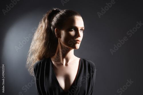 Fashion woman studio portrait with ponytail