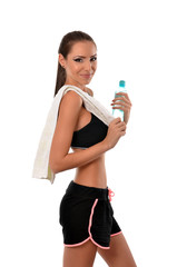 Athletic woman with towel and a bottle of water