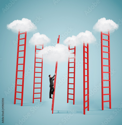 businessman climbing to cloud