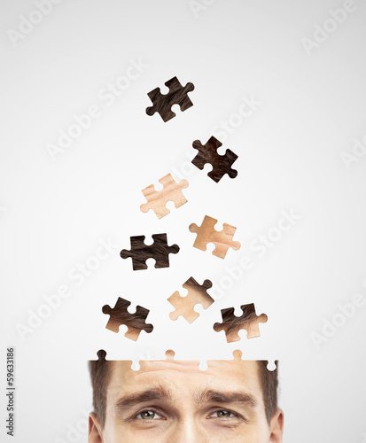 head built of puzzle