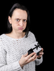 woman disappointed after opening gift, present